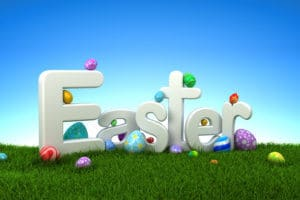 Easter text with colorful eggs on green grass with blue sky – 3d render